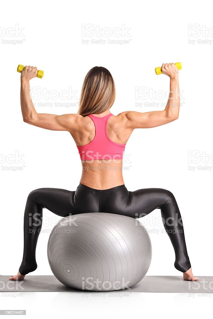 Female working out with dumb bells royalty-free stock photo
