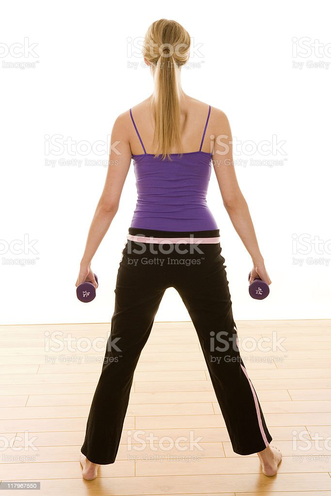 Female working out with dumbbell royalty-free stock photo