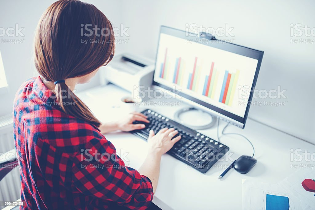 Female works in office stock photo