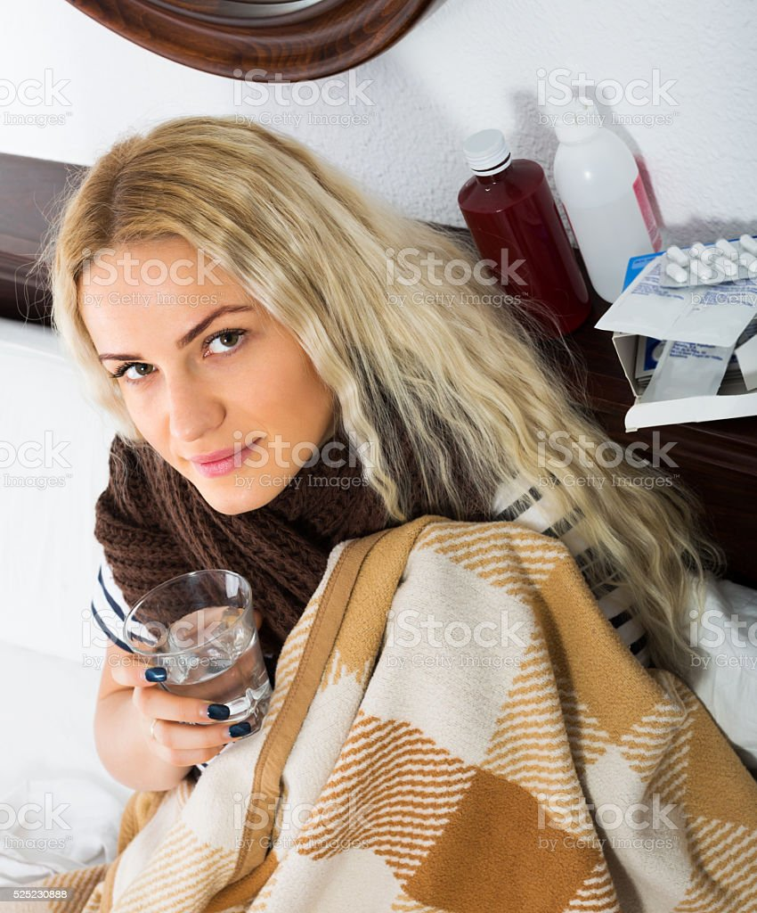 Female wrapping herself in scarf stock photo