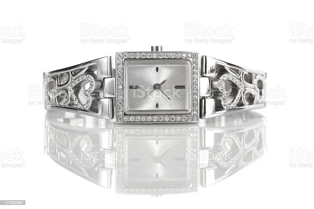 Female wrist watch with diamonds with reflection stock photo