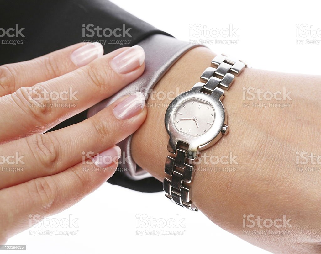 A female wrist wearing a watch and checking the time royalty-free stock photo