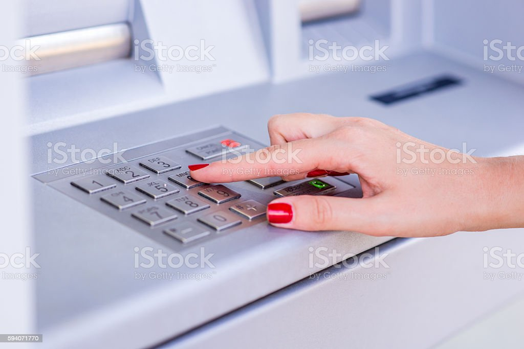 Female's Hand Typing Security Code stock photo
