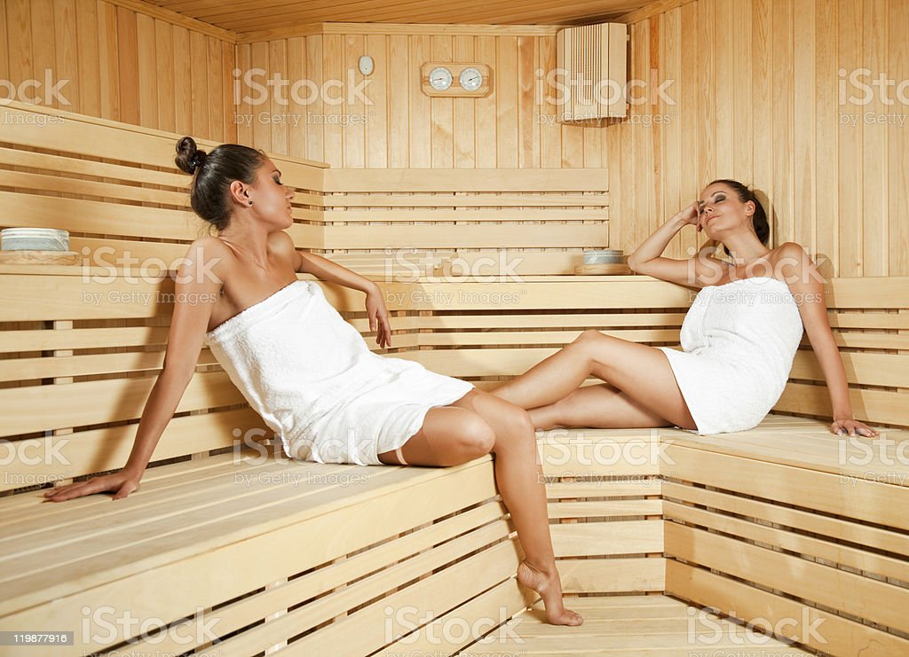 Females relaxing in sauna stock photo