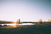 Females Running on Path During Sunset in Utah