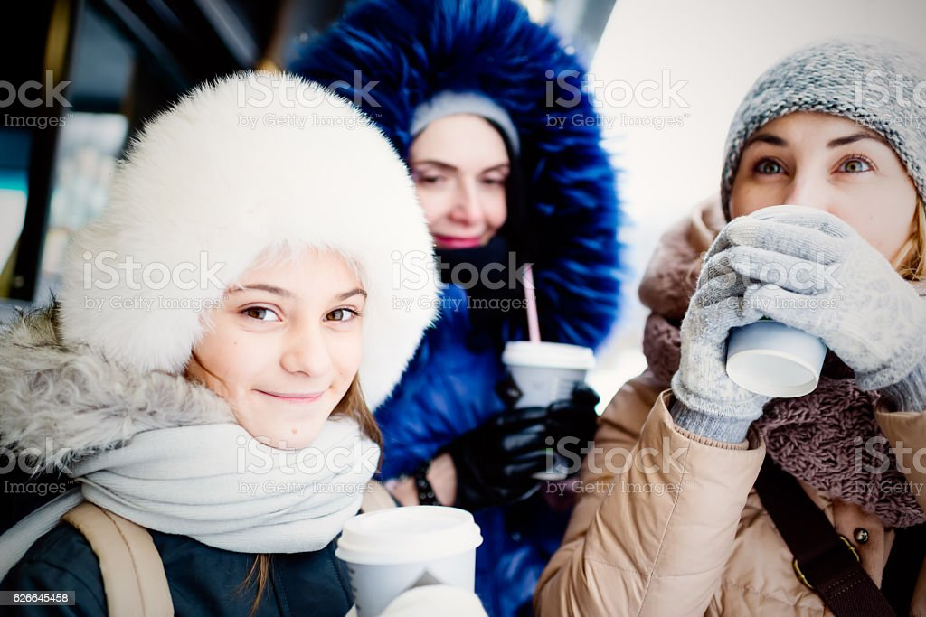 Females with plastic cups of hot drinks stock photo