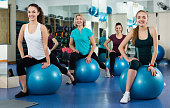 Females working out with aerobic ball