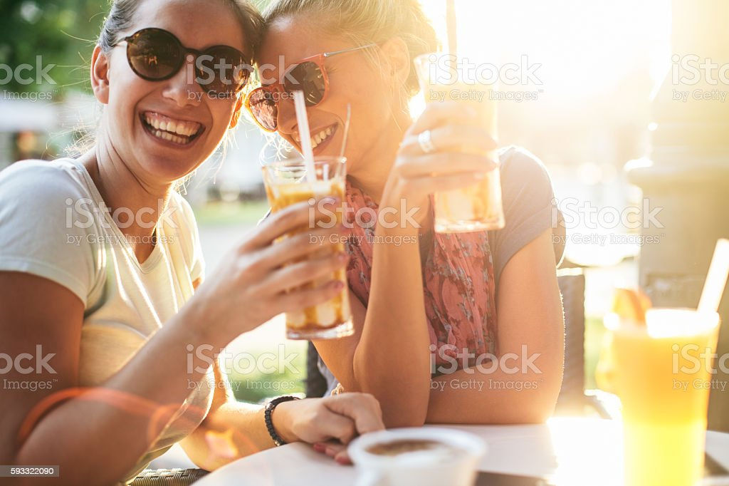 Femile friends having fun at sunset stock photo
