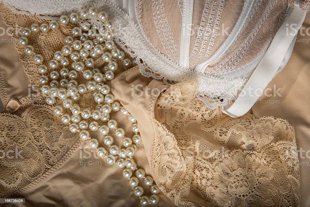 Feminine bra, perlas and underclothes royalty-free stock photo