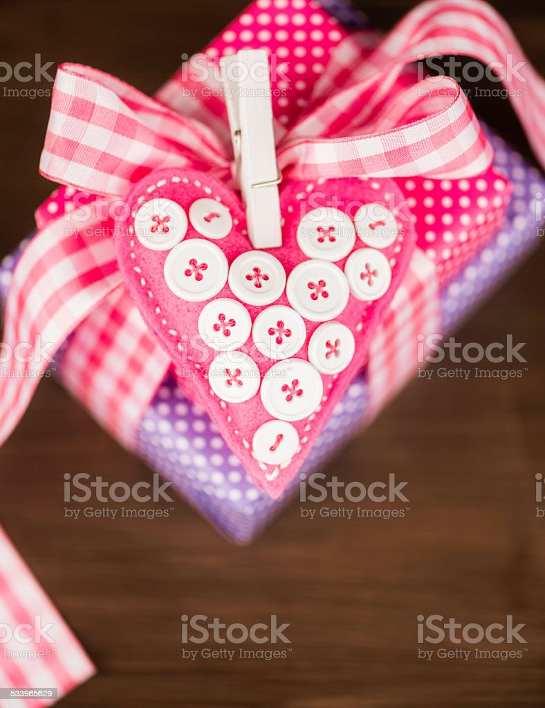 Feminine gifts with handcrafted heart. Valentine or wedding theme. stock photo