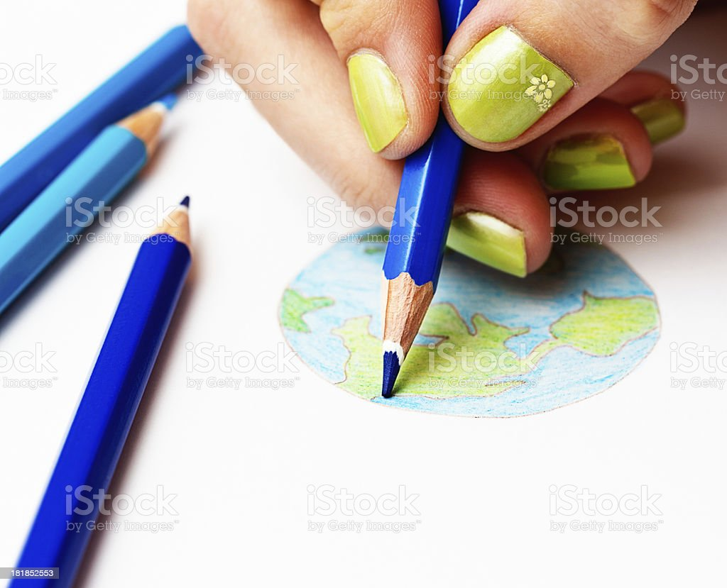 Feminine hand draws world map in crayon royalty-free stock photo