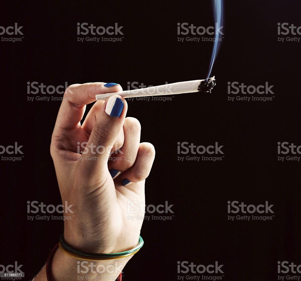 Feminine hand holding marijuana joint stock photo