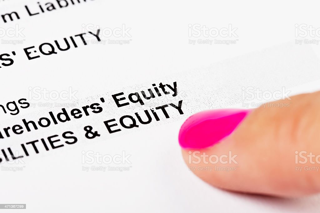 Feminine hand points to Equity on financial spreadsheet stock photo