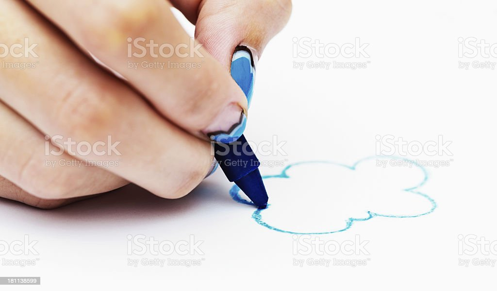 Feminine hand sketches clouds on white royalty-free stock photo
