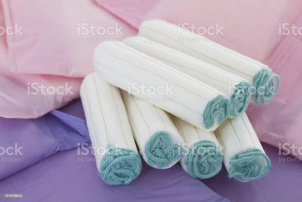 Feminine sanitary pads and tamping stock photo