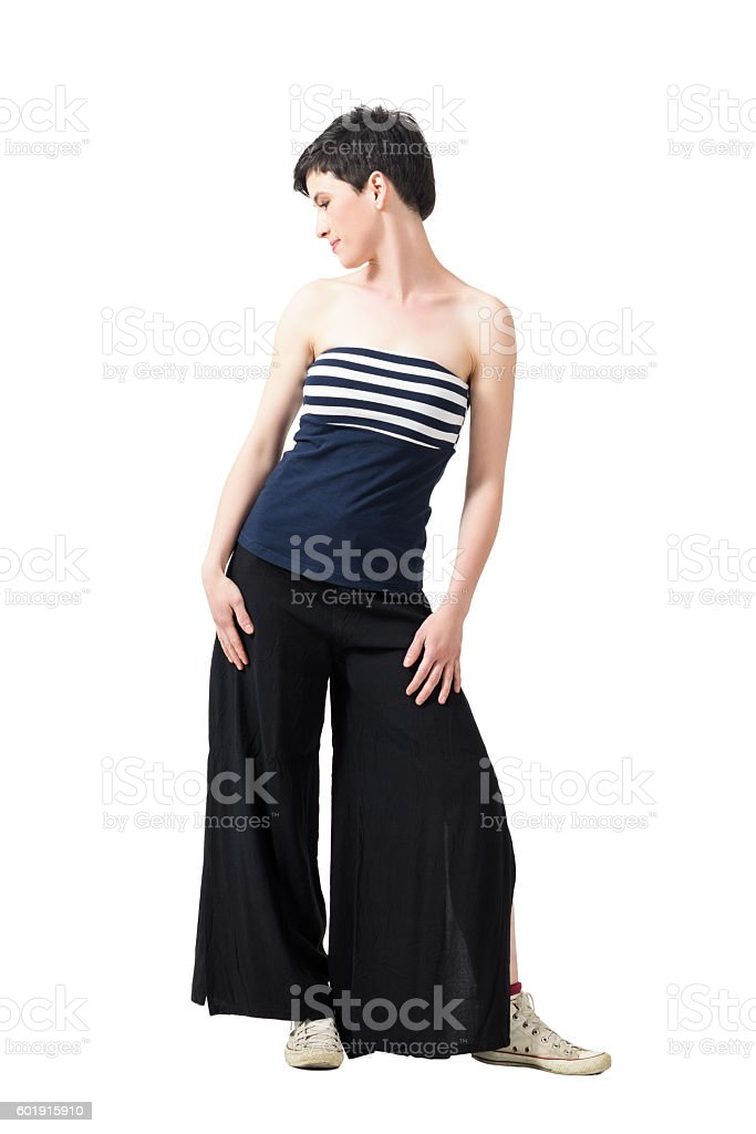 Feminine short hair woman in off the shoulder top posing stock photo