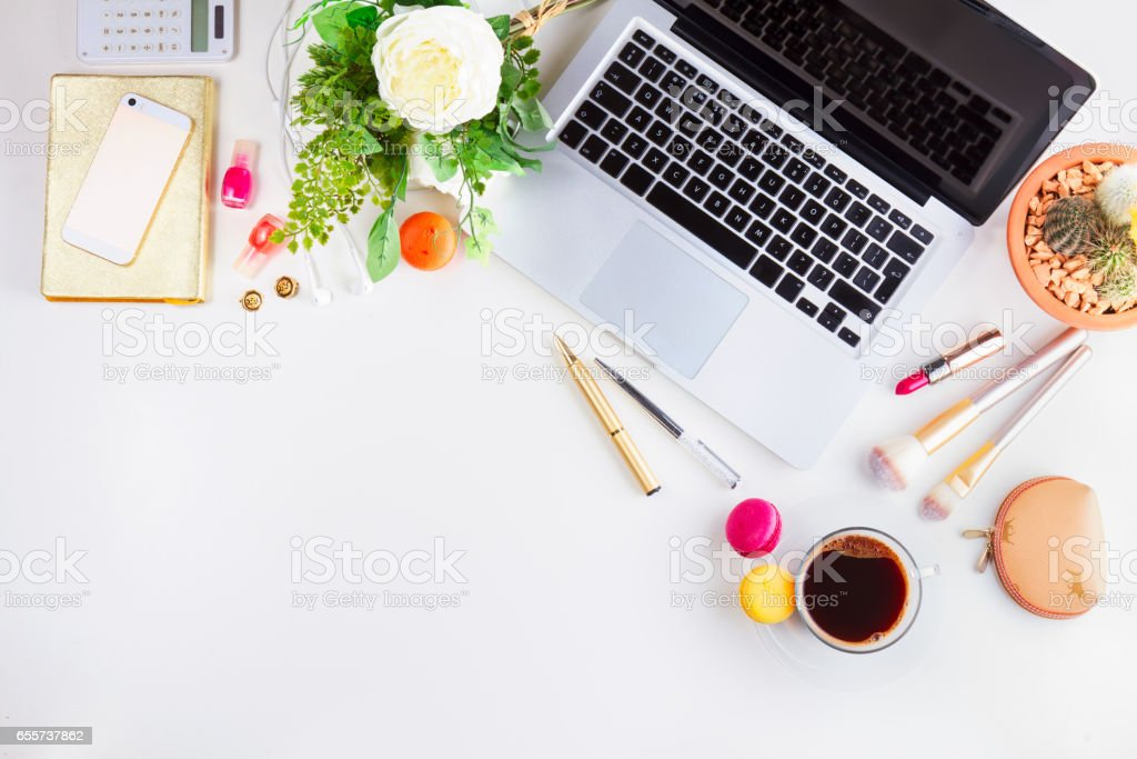 Feminine workspace border with keyboard, coffee and flowers, top view...