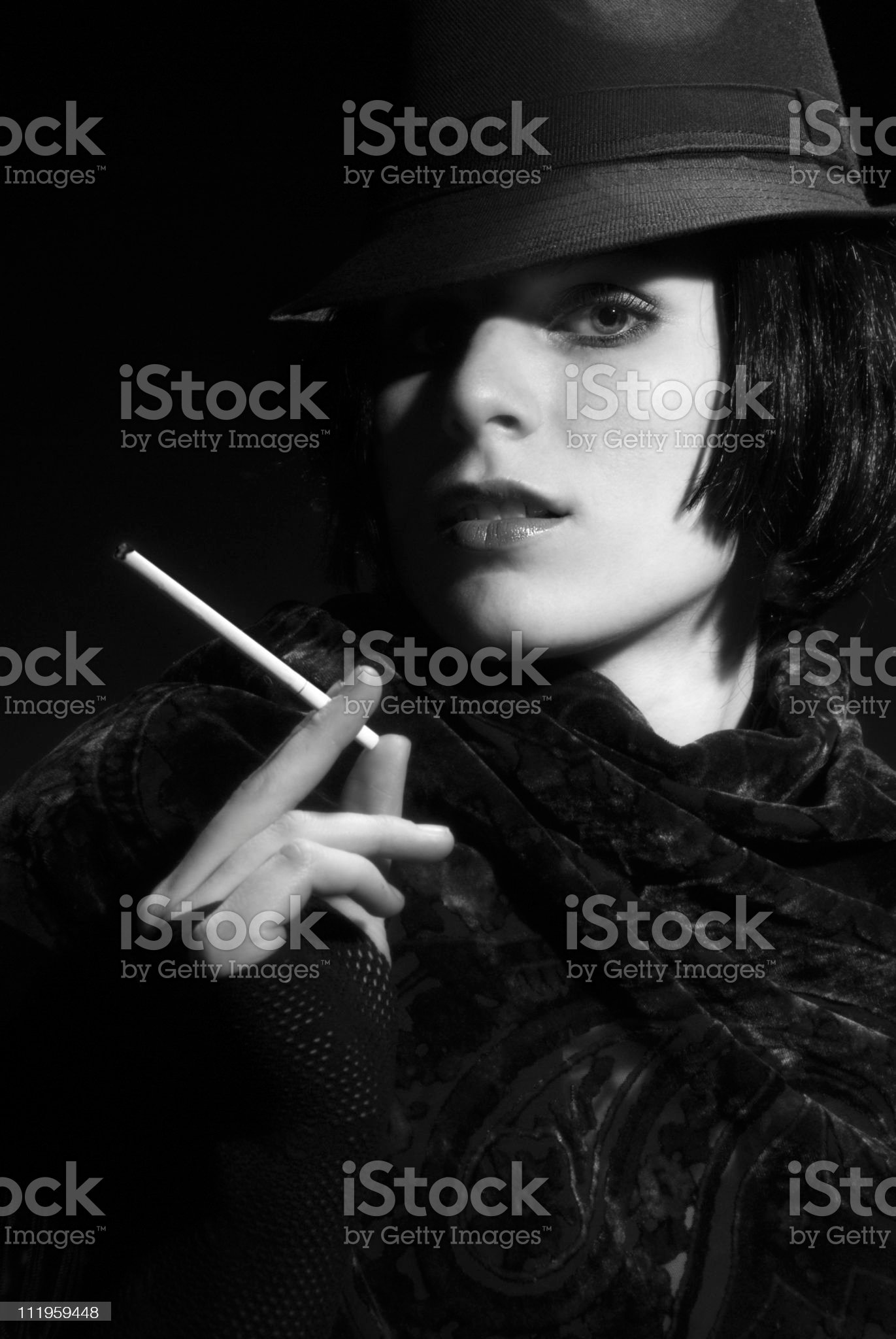 Femme Fatal: beautiful  woman wearing fedora on black background royalty-free stock photo