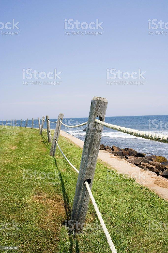 Fence along the coastline stock photo