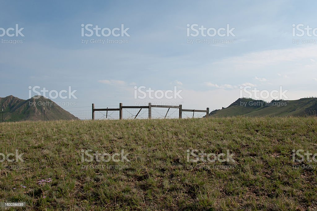 Fence and Gate in the Mongolian Steppes royalty-free stock photo