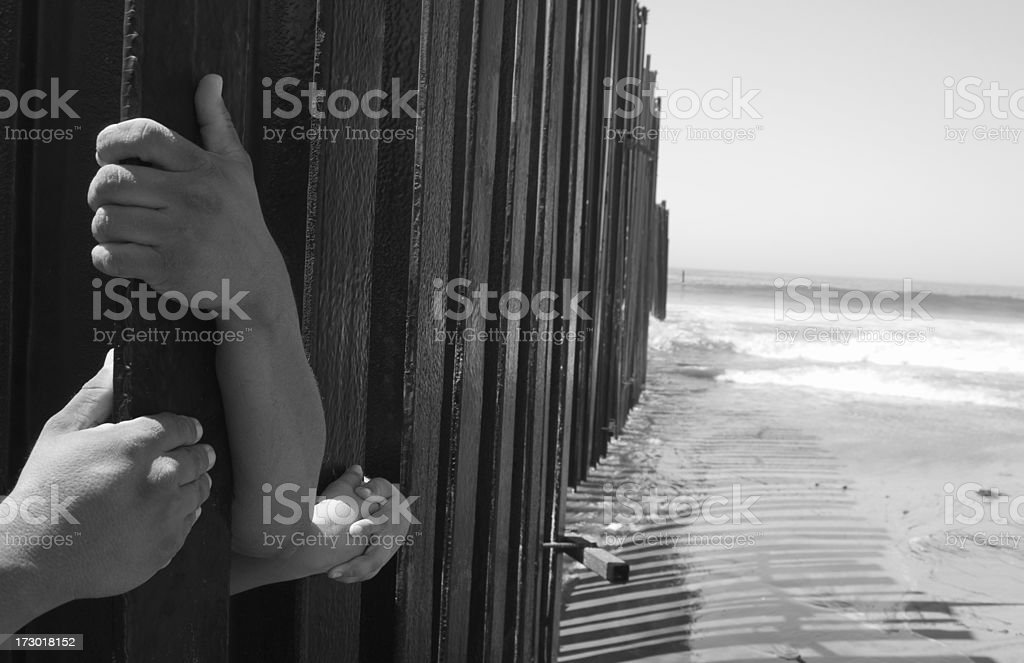 Fence and Hands royalty-free stock photo
