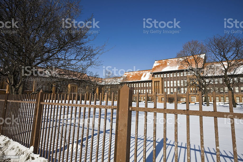 Fence and High School in Chicago stock photo