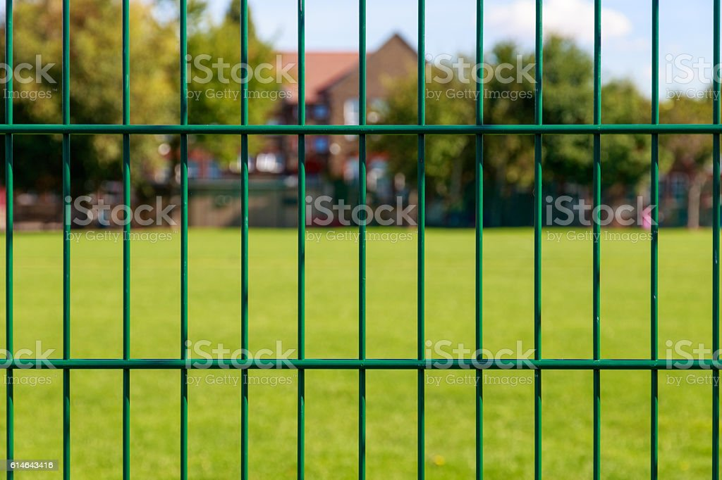 Fence and House stock photo