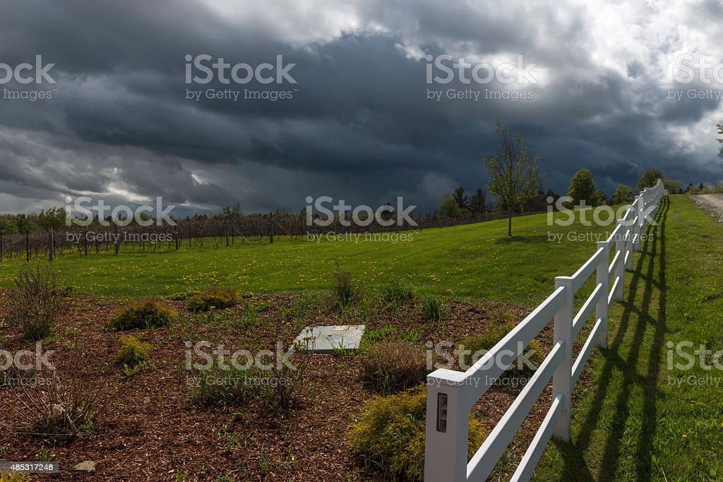 Fence and Storm Clouds Horizontal stock photo