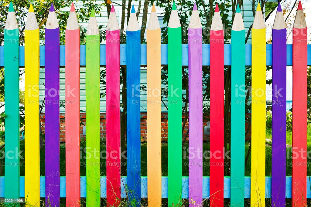 fence as colorful pencils stock photo
