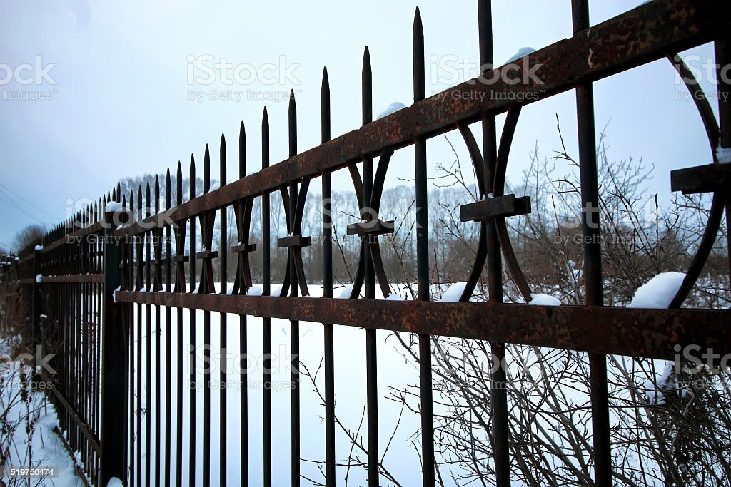 fence at an abandoned cemetery stock photo