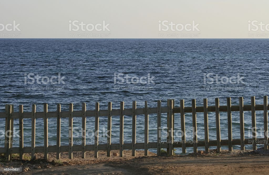 fence at the sea royalty-free stock photo
