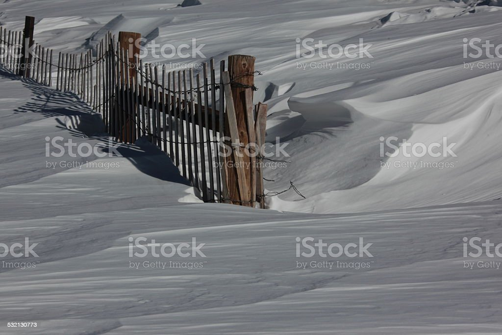 Fence Buried In Snow stock photo