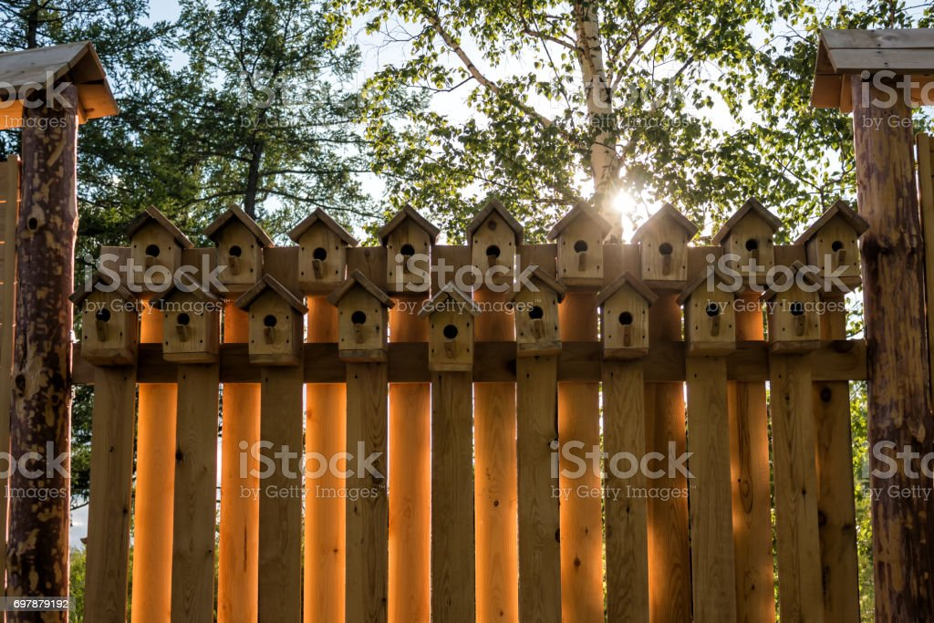 Fence from the birdhouses stock photo