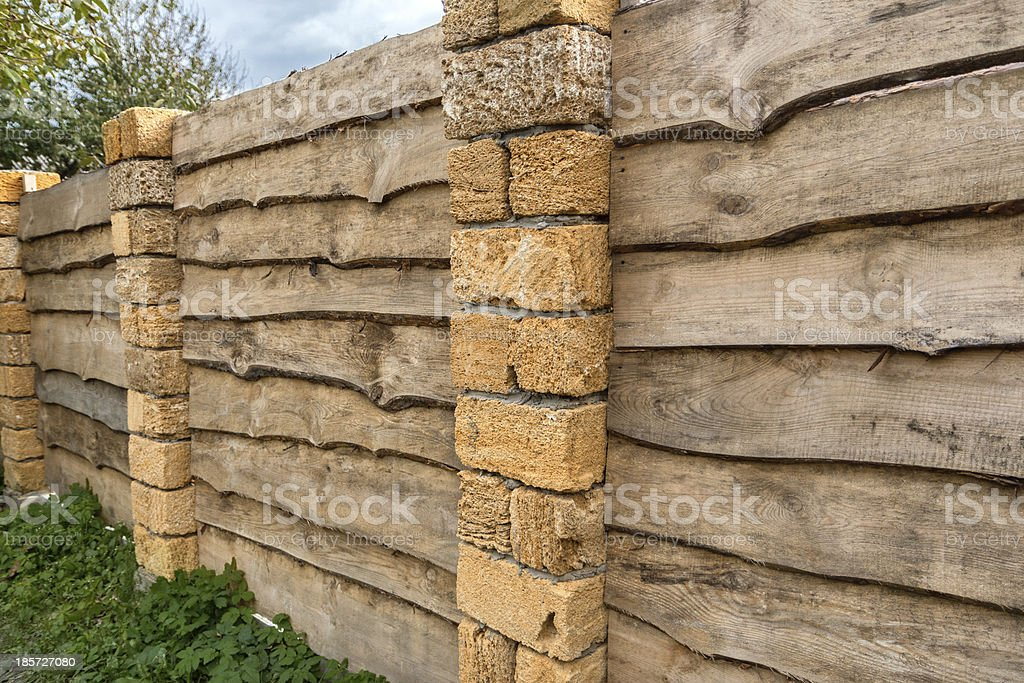 Fence from unedged board royalty-free stock photo