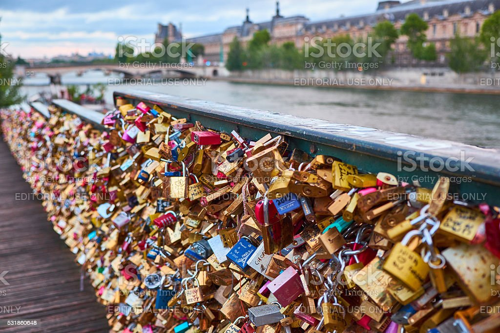 fence full of love locks in paris stock photo