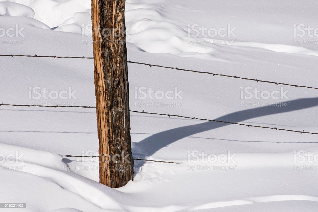 Fence in a Field of Snow stock photo