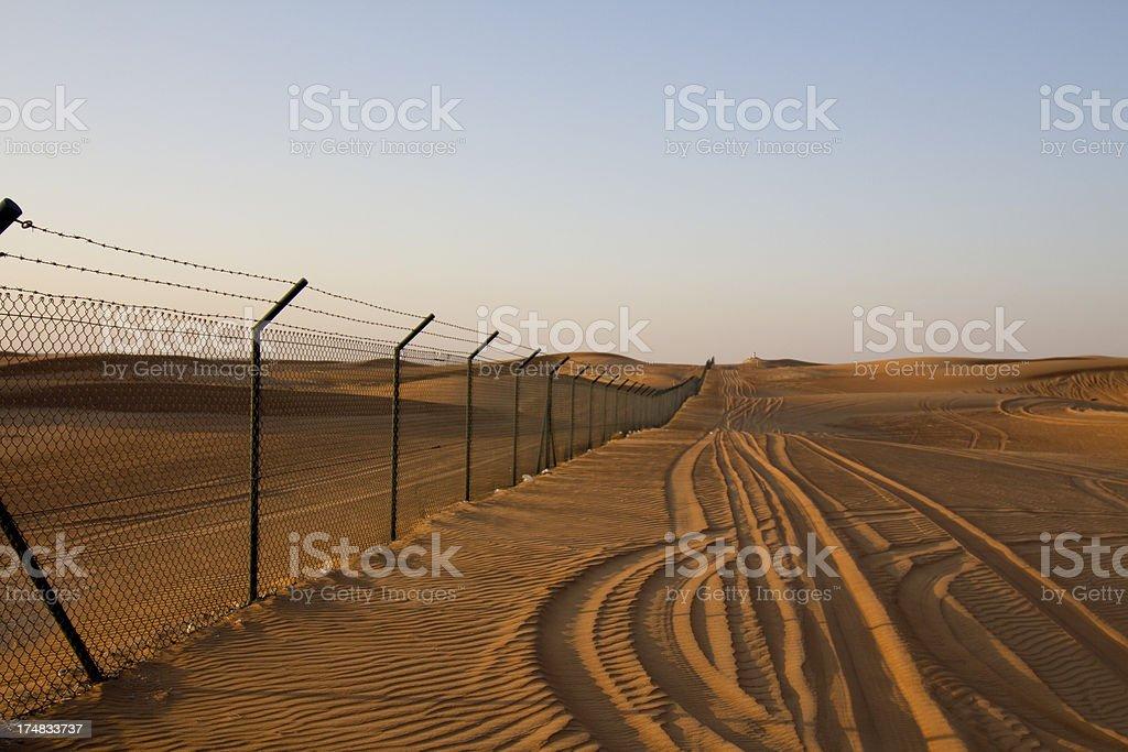 Fence in Desert stock photo