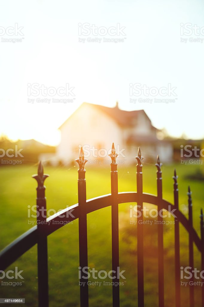 Fence in front of the house stock photo