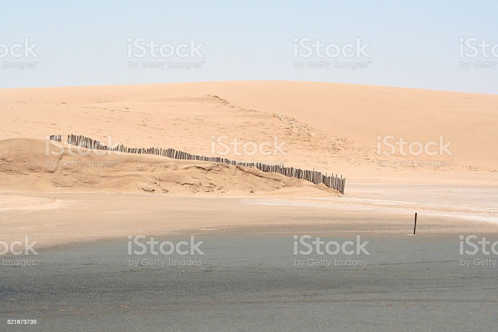 Fence in the Sand Dunes, Walvis Bay, Namibia, Africa stock photo