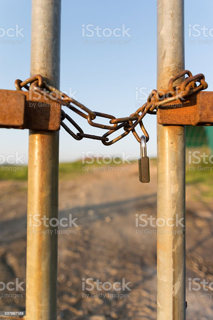 Fence locked chain vertical stock photo