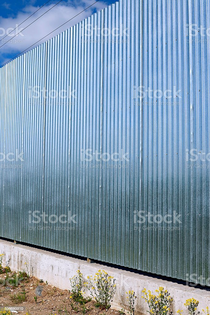 Fence made of galvanized, stainless steel professional flooring stock photo