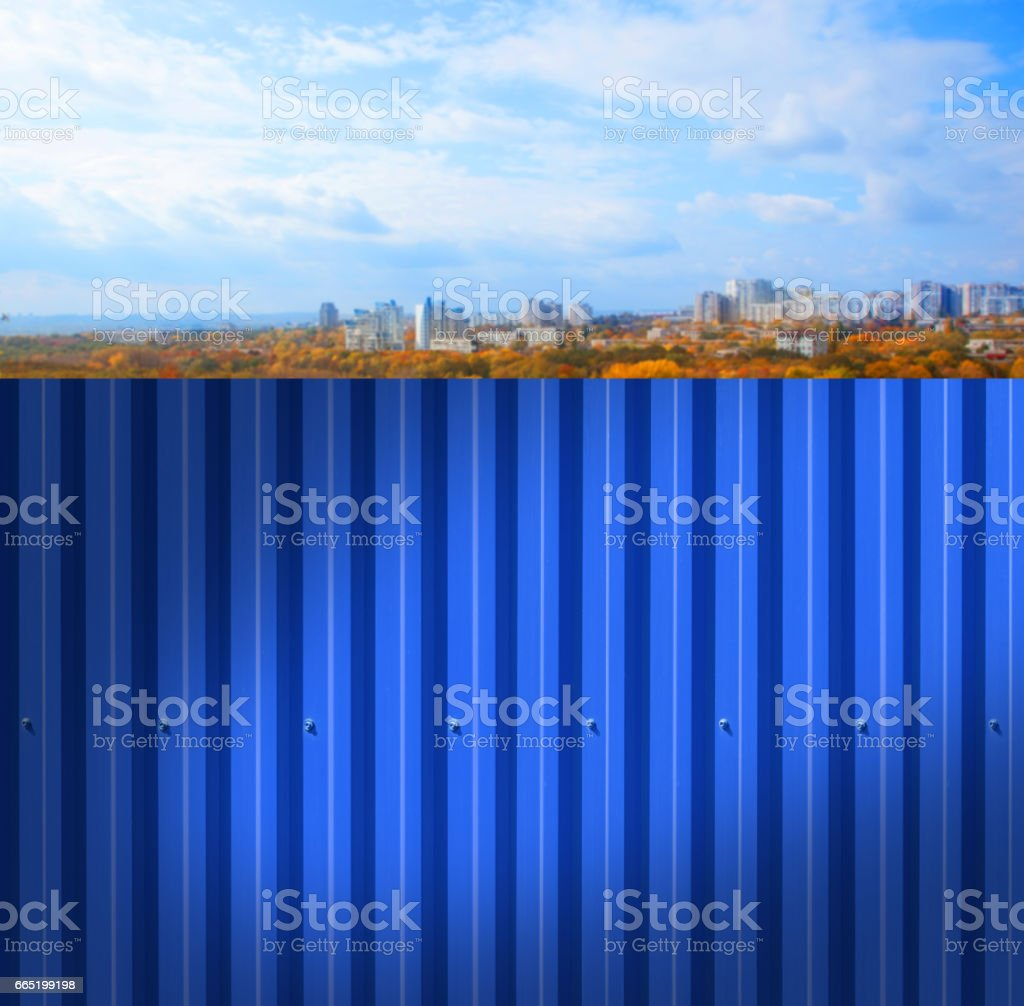 Fence made of metal panels a blue color outdoors stock photo