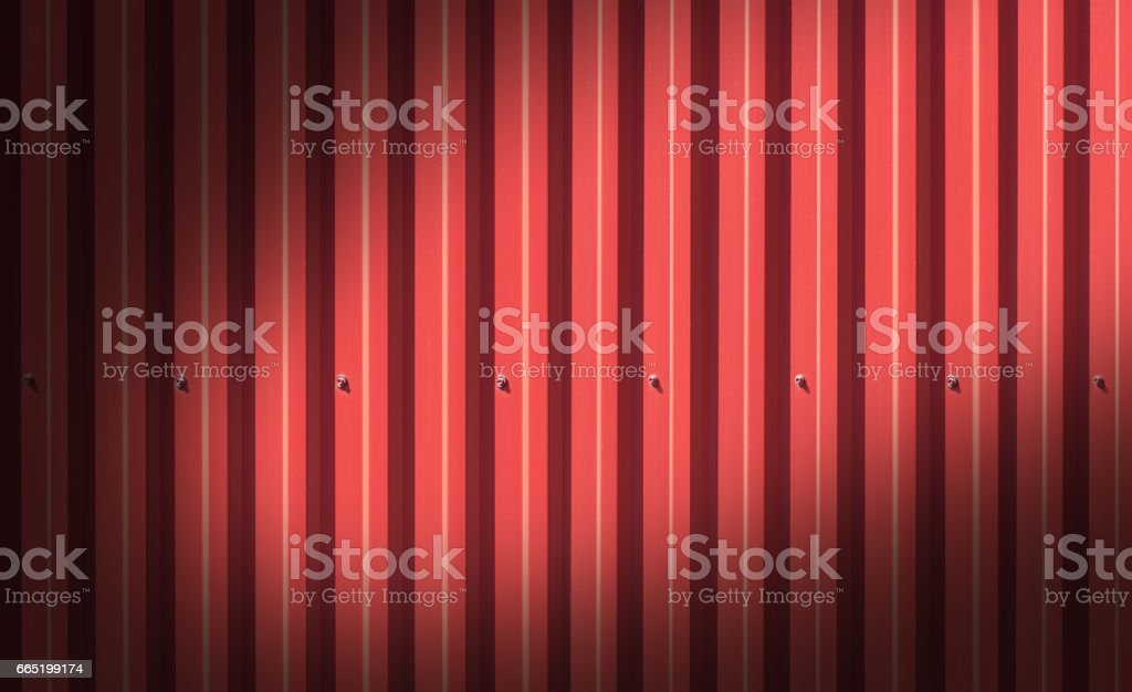 Fence made of metal panels a red color outdoors stock photo