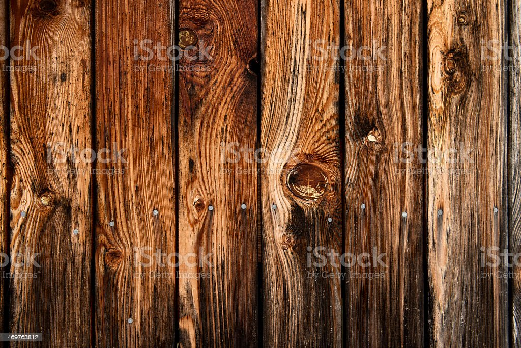 Fence made of wooden planks with visible grain marks stock photo