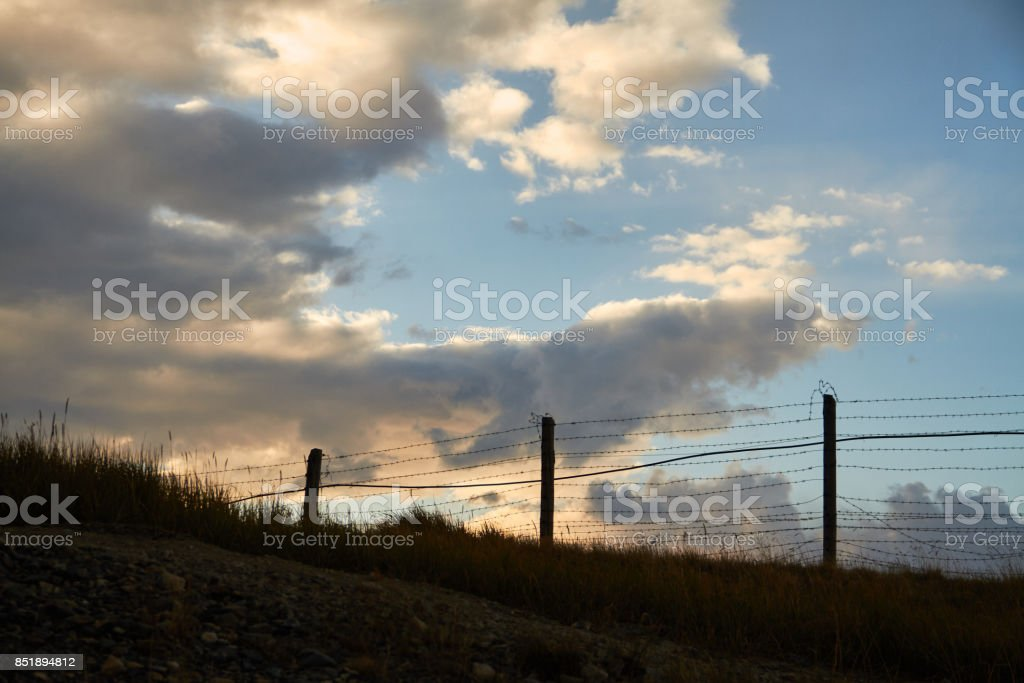 Fence of barbed wire on the border with Mongolia. Ukok Plateau Of Altai. Fabulous cold landscapes. No one around stock photo