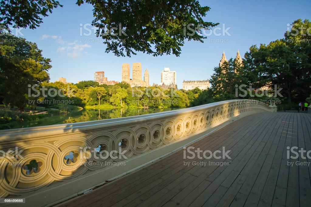 Fence of Bow bridge and walkway at Central Park, New York stock photo