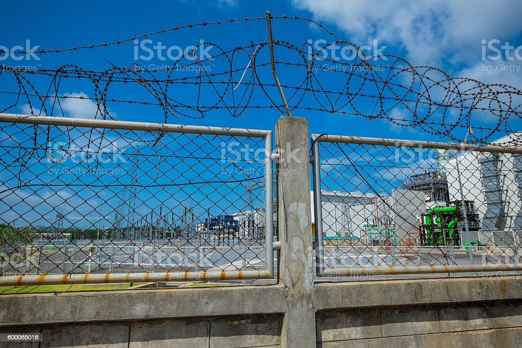 Fence of power plant stock photo