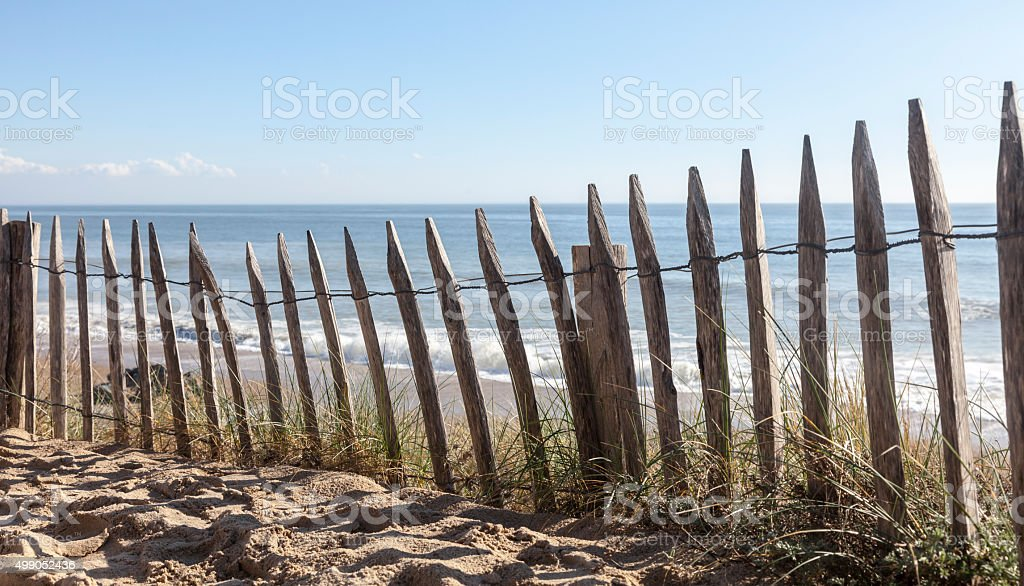 Fence on a Sand Dune stock photo