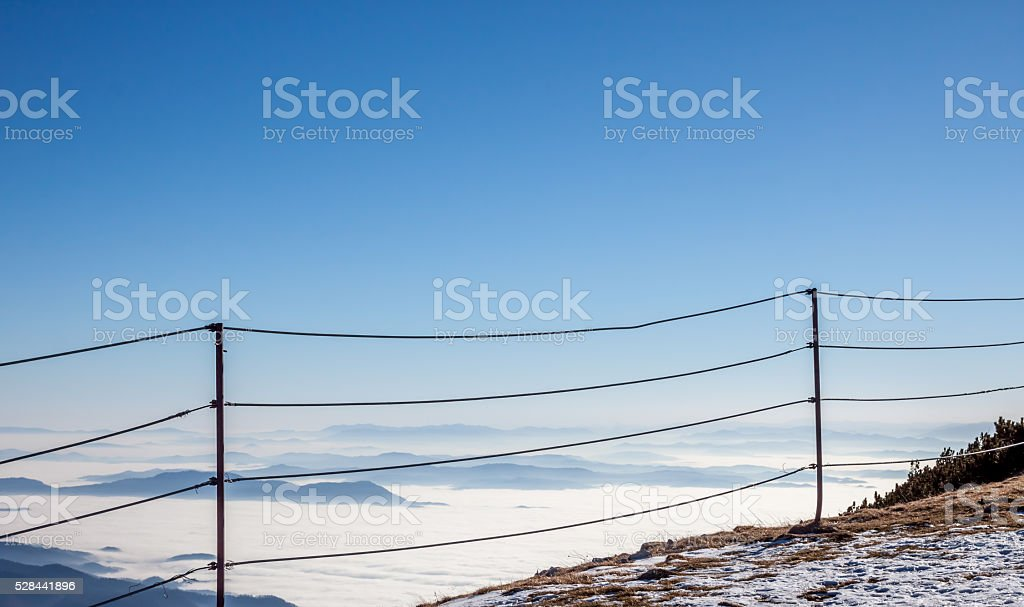 fence on top ot the mountain stock photo
