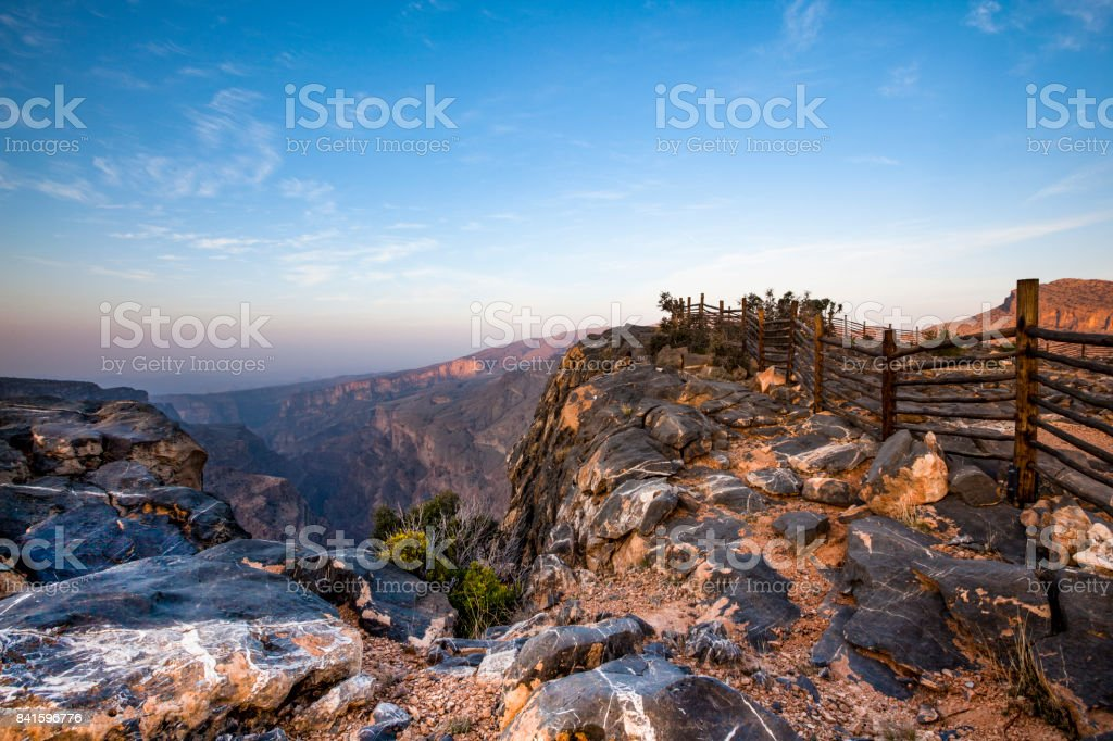 fence on wadi ghul, grand canyon of oman stock photo
